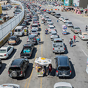 The queue of cars and people entering into the United States, seen from the border bridge that links Tijuana to San Ysidro, on the American side of the border