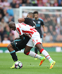 Bruno Martins Indi of Stoke City (L) and Jose Salomon Rondon of West Bromwich Albion in action - Mandatory by-line: Jack Phillips/JMP - 24/09/2016 - FOOTBALL - Bet365 Stadium - Stoke-on-Trent, England - Stoke City v West Bromwich Albion - Premier League