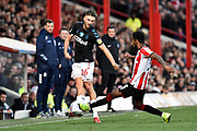 Lewis Wing (26) of Middlesbrough battles for possession with Rico Henry (3) of Brentford during the EFL Sky Bet Championship match between Brentford and Middlesbrough at Griffin Park, London, England on 8 February 2020.