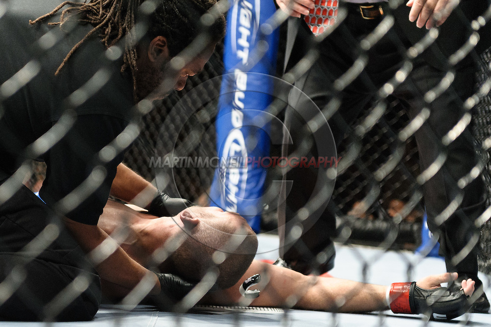 "LAS VEGAS, NEVADA. JULY 11, 2009: Matt Grice lays on the canvas whilst being checked over by the referee during ""UFC 100: Making History"" inside the Mandalay Bay Events Center in Las Vegas, Nevada."
