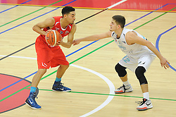 Roy Owen of Bristol Flyers is challenged by Elvis Dusha of Surrey Scorchers - Mandatory byline: Dougie Allward/JMP - 07966 386802 - 19/09/2015 - BASKETBALL - SGS Wise Campus - Bristol, England - Bristol Flyers v Surrey Scorchers - British Basketball League
