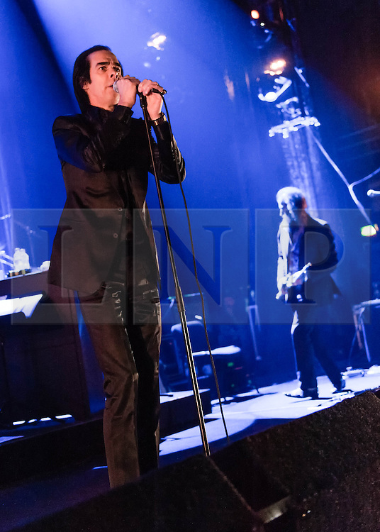 © Licensed to London News Pictures. 26/10/2013. London, UK.   Nick Cave and the Bad Seeds performing live at Hammersmith Apollo. In this pic - Nick Cave (left), Warren Ellis (right).  Photo credit : Richard Isaac/LNP