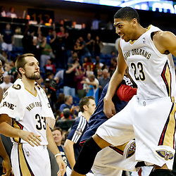 Nov 22, 2013; New Orleans, LA, USA; New Orleans Pelicans power forward Anthony Davis (23) celebrates a win against the Cleveland Cavaliers in a game at New Orleans Arena. The Pelicans defeated the Cavaliers 104-100. Mandatory Credit: Derick E. Hingle-USA TODAY Sports