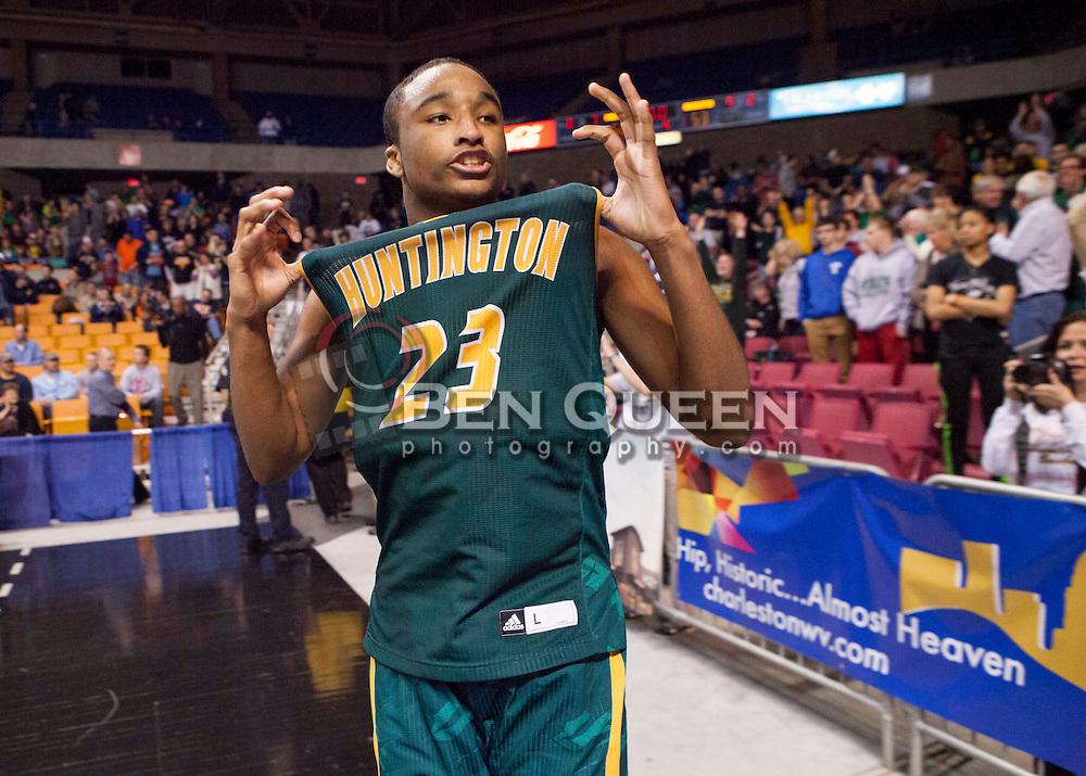 Huntington forward Jeffrey Howard (23) celebrates winning the Class AAA championship game at the Charleston Civic Center.