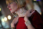 Zia Boutique sales executive Abigail Hastings wears a pair of crystal quartz and blue goldstone earrings at the shop in historic downtown Savannah. (Photo by Stephen Morton)