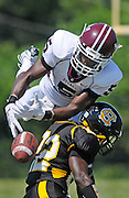 Sean Williams, Hazelwood Central, breaks up the reception by Durron Neal, DeSmet.
