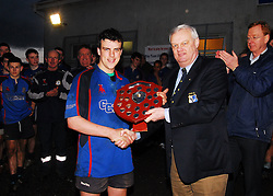 Westport U17's Connacht League Champions after their 17-13 victory over Galwegians in Tuam on saturday evening. Pat O'Toole Westport captain accepts the league trophy from Eamon Feely Junior Vice President Connacht Rugby...Pic Conor McKeown