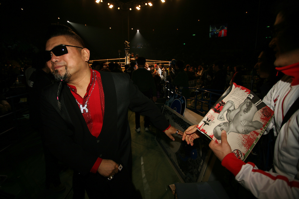Ringside announcer greets fan as  he  leaves..BUSHIDO Extreme Martial Art fighting Rules are quite limited and fights usually carry on past the bloody nose stage.  It's  very popular in Japan, goes out on primetime TV, fighters get paid as much as 4 million US Dollars a fight and are seen as celebs. Crowd consist of young families, couples etc. Piece will look at why sport is so successful in Japan, appealing to so called 'lost generation' of young people suffering from effects of collapse of economy/rise of unemployment.