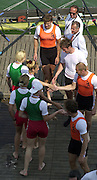 2003 - FISA World Cup Rowing Milan Italy.31/05/2003  - Photo Peter Spurrier.BLR W4X congratulate the NED M4X on the jetty. [Mandatory Credit: Peter Spurrier:Intersport Images]