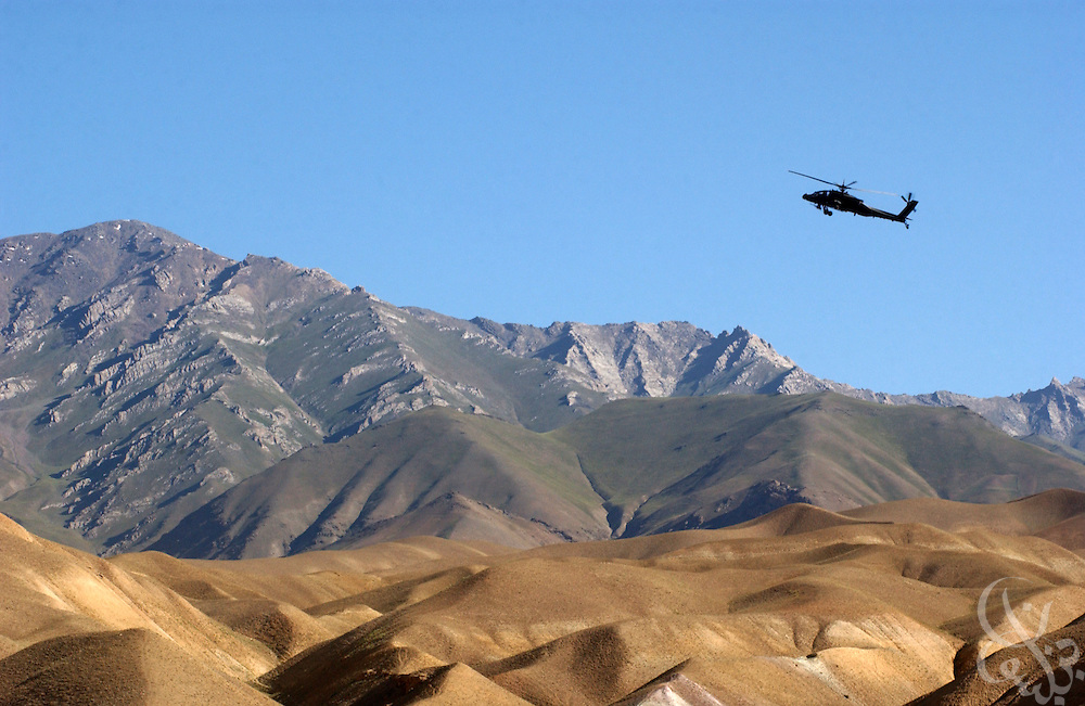 A U.S. Army Apache helicopter gunship gains altitude to clear a portion of the Baba mountain range June 17, 2002 near Bamiyan, Afghanistan. Coalition forces continue to scour Afghanistan for traces of remaining al Qaeda and Taliban fighters as part of the ongoing Operation Enduring Freedom.