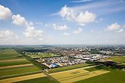 Nederland, Noord-Holland, Purmer, 14-07-2008; Oostelijk deel van de polder is nog gedeeltelijk ongerept, links van het water van de Middentocht; maar de verrommeling slaat toe,  in het midden bedrijventerrein de Baanstee met daar achter aangelegde (!) Purmerbos (met golfterrein); in de verdere achtergrond de meest recente stadsuitbreiding, de woonwijken Purmer-Noord en Purmer-Zuid; in de schaduw aan de Westerweg enkele van de laatste boerderijen. .luchtfoto (toeslag); aerial photo (additional fee required); .foto Siebe Swart / photo Siebe Swart