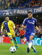 César Azpilicueta plays a pass to Loïc Rémy during the Champions League match between Chelsea and Maccabi Tel Aviv at Stamford Bridge, London, England on 16 September 2015. Photo by Andy Walter.