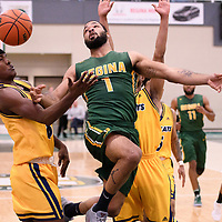 4th year forward Shawn Lathan (1) of the Regina Cougars in action during the Men's Basketball home game on January  20 at Centre for Kinesiology, Health and Sport. Credit: /Arthur Images