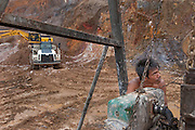 Worker repares a pumping station in the Pemali mine, the biggest legal mine in Bangka that has completely devastated the once green landscape. Operated by PT-Timah. It produces 60 tons of tin per month. Indonesia is the worlds biggest tin provider, vital for assembling smart phones and other electronic products.  Bangka Island (Indonesia) is devastated by tin mines. The demand for tin has increased due to its use in smart phones and tablets.<br /> <br /> Mineurs réparent une station de pompage dans la Mine de Pemali, la plus grande mine légale de Bangka, qui a complètement dévasté un paysage qui était autrefois verte.  Exploité par PT-Timah, elle produit 60 tonnes d'étain par mois. L'Indonésie est le plus grand fournisseur mondes d'étain, vital pour l'assemblage des téléphones et autres produits électroniques. L'île de Bangka (Indonésie) est dévastée par des mines d'étain. La demande de l'étain a explosé à cause de son utilisation dans les smartphones et tablettes