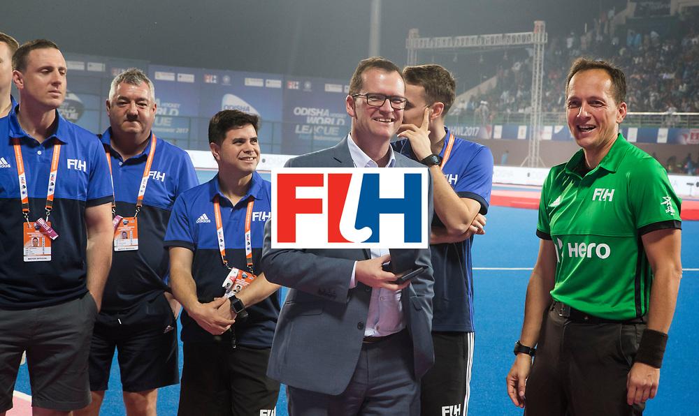 BHUBANESWAR - The Odisha Men's Hockey World League Final . Match ID 01 . Umpire Eduardo Lizana received the golden whistle  from FIH CEO , Jason McCracken.    WORLDSPORTPICS COPYRIGHT  KOEN SUYK