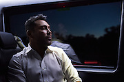 Oscar De La Hoya gets a moment to himself the ride back to the hotel at the end of the night in Grapevine, Texas on September 16, 2016.  (Cooper Neill for ESPN)
