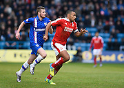 Gillingham forward Rory Donnelly and Swindon defender Nathan Thompson in a race for the ball during the Sky Bet League 1 match between Gillingham and Swindon Town at the MEMS Priestfield Stadium, Gillingham, England on 6 February 2016. Photo by David Charbit.