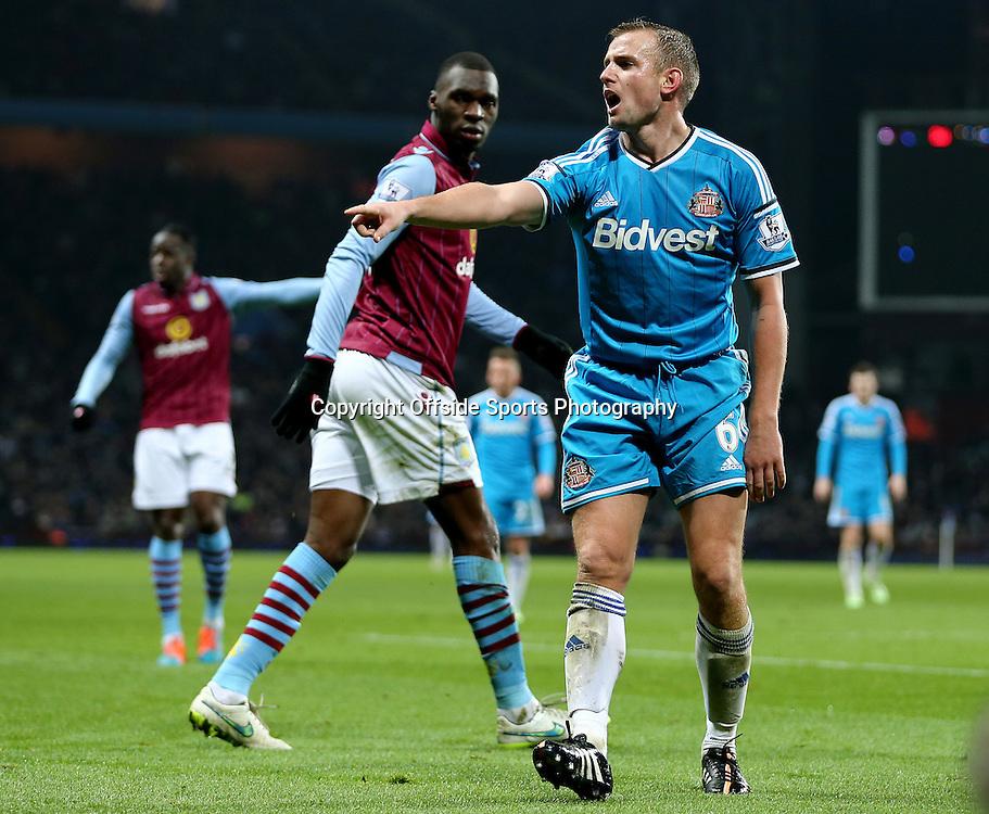 28th December 2014 - Barclays Premier League - Aston Villa v Sunderland - Lee Cattermole of Sunderland appeals for a corner - Photo: Paul Roberts / Offside.