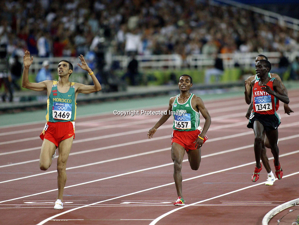 Hicham El Guerrouj (MAR) celebrates after winning the Men's 5000 metres, Olympic Games, Athens, Greece. 28 August 2004<br />Please credit: Photosport