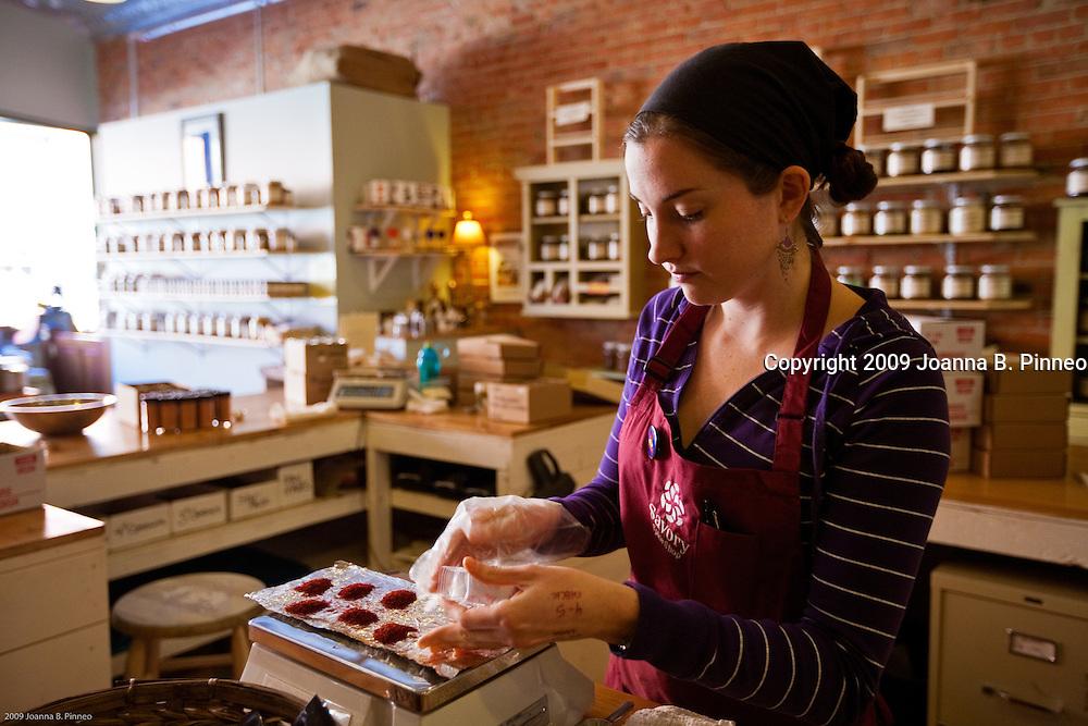 Savory Spice Shop, Boulder, Colorado. Leila Mcfadden fills bags with Spanish Coupe Saffron.