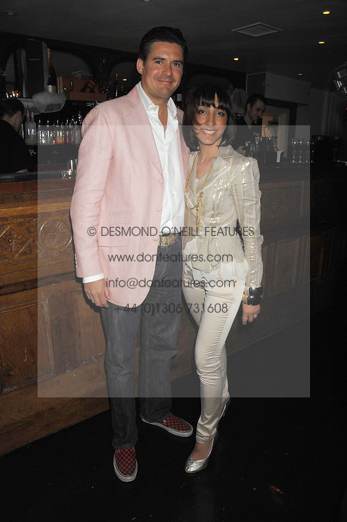EDWARD TAYLOR and GEETA DUTT at a party to launch the new upstairs area of Mamilanji, 107 Kings Road, London SW3 on 19th April 2007.<br />