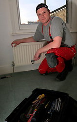 UK ENGLAND LONDON 27FEB09 - Polish plumber Andrzej (surname withheld) fixes a radiator leak in a house in Tooting, south London. Due to the worsening economic situation in Britain and the resultant lack of work, he will return home to Poland next month ..jre/Photo by Jiri Rezac..© Jiri Rezac 2009