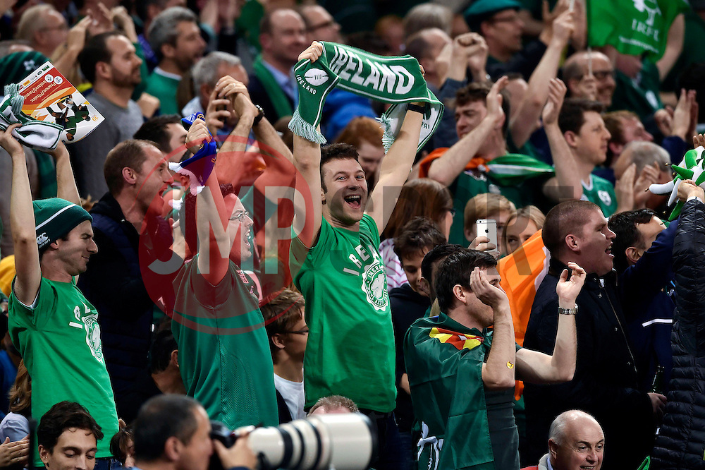 Ireland supporters in the crowd celebrate a try - Mandatory byline: Patrick Khachfe/JMP - 07966 386802 - 11/10/2015 - RUGBY UNION - Millennium Stadium - Cardiff, Wales - France v Ireland - Rugby World Cup 2015 Pool D.
