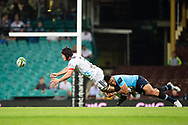 SYDNEY, NSW - MARCH 23: Crusaders player Matt Todd (7) tackled by Waratahs player Israel Folau (15) as he gets the pass away at round 6 of Super Rugby between NSW Waratahs and Crusaders on March 23, 2019 at The Sydney Cricket Ground, NSW. (Photo by Speed Media/Icon Sportswire)