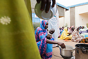 Habsita Moussa, 30, stirs nutritional porridge she and other women are learning to prepare during a training session in Mongo, Guera province, Chad on Wednesday October 17, 2012. Local NGO CELIAF is trained by UNICEF to in turn provide women with trainings on nutrition and health issues.