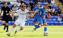 Louis Reed of Peterborough United in action with Adam Le Fondre of Bolton Wanderers - Mandatory by-line: Joe Dent/JMP - 28/07/2018 - FOOTBALL - ABAX Stadium - Peterborough, England - Peterborough United v Bolton Wanderers - Pre-season friendly