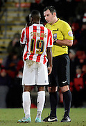 Referee Tim Robinson has a word to Omari Sterling-James during the Sky Bet League 2 match between Cheltenham Town and Morecambe at Whaddon Road, Cheltenham, England on 16 January 2015. Photo by Alan Franklin.