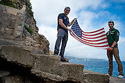 Monaco Grand Prix 2014, GP2 drivers Conor Daly (left) and Alexander Rossi hold an American flag near Monaco's harbor.
