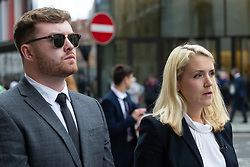 DCI Katherine Goodwin from the Met's homicide command , with Nial Galbally, son of Catherine Burke, gives a statement outside The Old Bailey in London following the sentencing of Kasim Lewis for the murder of Catherine Burke, a 55-year-old retired council worker, at her home in Muswell Hill, north London, in November 2017, a month before he killed 22yo Iuliana Tudos. London, July 18 2019.