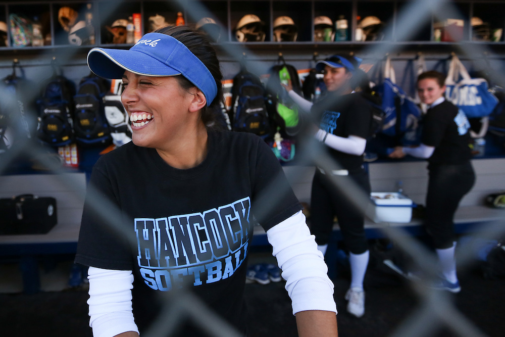 Allan Hancock College outfielder Elysha Cortez stays loose before a game at Cal State Fullerton on Friday, Nov. 7, 2014. (Charles Hall/Sports Shooter Academy XI)