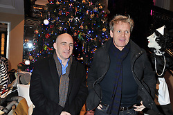 Left to right, STUART GILLIES and GORDON RAMSAY at the unveiling of the Claridge's Christmas tree 2011 designed by Alber Elbaz for Lanvin held at Claridge's, Brook Street, London on 5th December 2011.