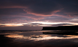 © Licensed to London News Pictures. 25/03/2014<br /> <br /> Saltburn, Cleveland, United Kingdom<br /> <br /> The morning light is reflected in wet sand as dawn starts to break over the beach in Saltburn by the Sea, Cleveland.<br /> <br /> Photo credit : Ian Forsyth/LNP