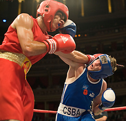 © Licensed to London News Pictures. London, UK  07/10/2011. FREDDIE ROSADO, US Marine Corp (Left) Vs SEAN DICK, UK Army (Right).  Members of the UK and US Armed Forces take part in the Royal Albert Hall cup boxing match. This is the first time a boxing event has taken place in the historic venue following a court ruling banning the use of the hall for boxing and wrestling in 1999. The Court of Appeal subsequently overturned the decision earlier this year. The venue has hosted some of the greatest names in British boxing including Sir Henry Cooper, Frank Bruno, Lennox Lewis and Prince Naseem Hamed. Photo credit: Ben Cawthra/LNP