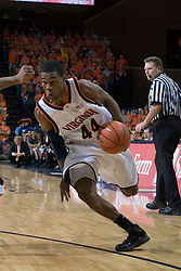 Virginia's Sean Singletary (44) dribbles around a Wake Forest defender.  The Virginia Cavaliers defeated the Wake Forest Demon Decons 88-76 at the John Paul Jones Arena in Charlottesville, VA on January 21, 2007.