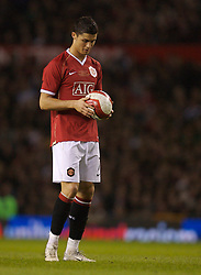 Manchester, England - Tuesday, March 13, 2007: Manchester United's Christiano Ronaldo prepares to take a free-kick, from which he scored the third goal, against Europe XI during the UEFA Celebration Match at Old Trafford. (Pic by David Rawcliffe/Propaganda)