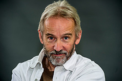 Pictured: Jasper FForde<br /> <br /> Jasper Fforde (born 11 January 1961) is a British novelist. Fforde's first novel, The Eyre Affair, was published in 2001. Fforde is known mainly for his Thursday Next novels. He has published two books in the loosely connected Nursery Crime series, and has published the first books of two additional independent series, The Last Dragonslayer and Shades of Grey.<br /> <br /> Fforde's books contain a profusion of literary allusions and wordplay, tightly scripted plots, and playfulness with the conventions of traditional genres. His works usually contain elements of metafiction, parody, and fantasy. <br /> <br /> Ger Harley   EEm 11 August 2018