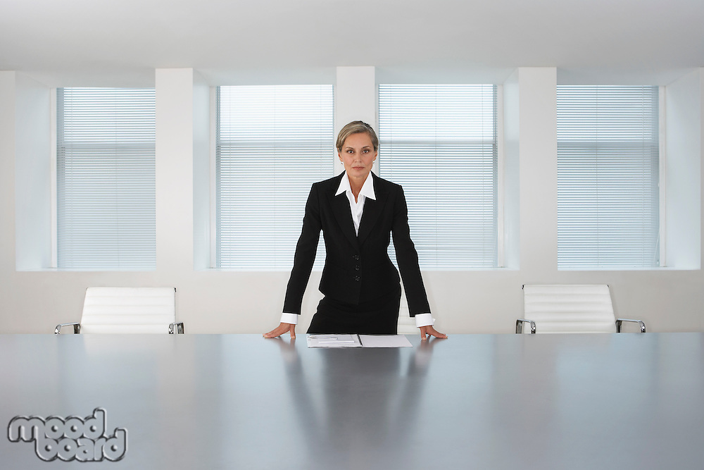 Business Executive Standing in Conference Room