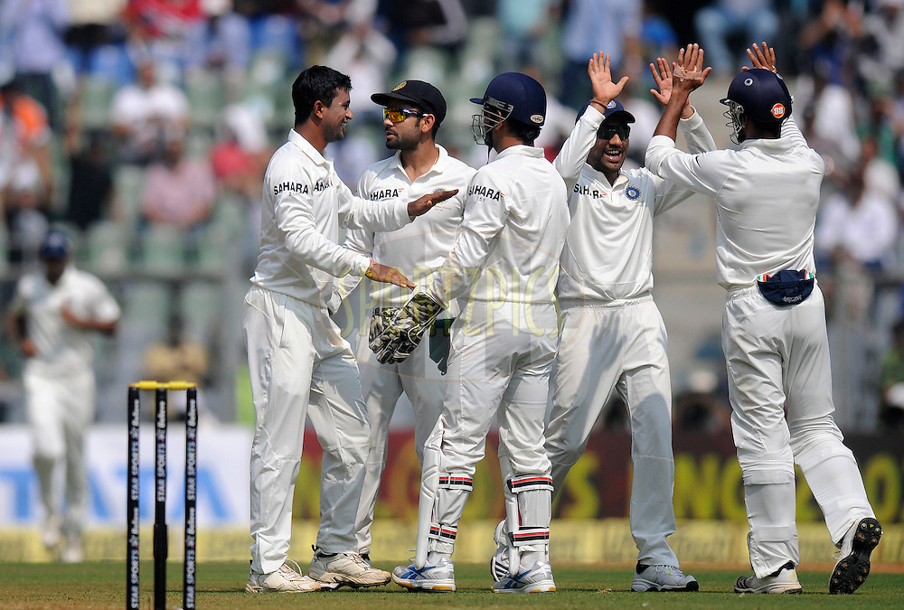 Pragyan Ojha of India celebrates the wicket of Kieran Powell of West Indiesduring day one of the second Star Sports test match between India and The West Indies held at The Wankhede Stadium in Mumbai, India on the 14th November 2013<br /> <br /> This test match is the 200th test match for Sachin Tendulkar and his last for India.  After a career spanning more than 24yrs Sachin is retiring from cricket and this test match is his last appearance on the field of play.<br /> <br /> Photo by: Pal PIllai - BCCI - SPORTZPICS<br /> <br /> Use of this image is subject to the terms and conditions as outlined by the BCCI. These terms can be found by following this link:<br /> <br /> http://sportzpics.photoshelter.com/gallery/BCCI-Image-Terms/G0000ahUVIIEBQ84/C0000whs75.ajndY