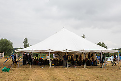 Roydon, Essex, UK. 27 July, 2019. Tents and marquees at Reclaim The Power's Power Beyond Borders mass action camp.