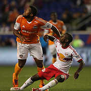 Bradley Wright-Phillips, New York Red Bulls, is challenged by Jermaine Taylor, Houston Dynamo, during the New York Red Bulls Vs Houston Dynamo, Major League Soccer regular season match at Red Bull Arena, Harrison, New Jersey. USA. 4th October 2014. Photo Tim Clayton