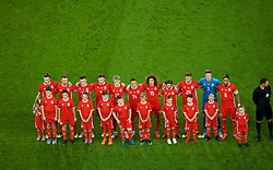 CARDIFF, WALES - Thursday, September 6, 2018: Wales players stand for the national anthem with mascots before the UEFA Nations League Group Stage League B Group 4 match between Wales and Republic of Ireland at the Cardiff City Stadium. Gareth Bale, Aaron Ramsey, Tom Lawrence, Ben Davies, David Brooks, Connor Roberts, Ethan Ampadu, Joe Allen, Chris Mepham, goalkeeper Wayne Hennessey and captain Ashley Williams. (Pic by Laura Malkin/Propaganda)