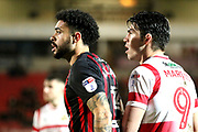 Blackburn Rovers defender Derrick Williams (3) and Doncaster Rovers striker John Marquis (9)  during the EFL Sky Bet League 1 match between Doncaster Rovers and Blackburn Rovers at the Keepmoat Stadium, Doncaster, England on 24 April 2018. Picture by Mick Atkins.