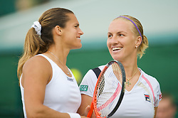 LONDON, ENGLAND - Friday, June 26, 2009: Amelie Mauresmo (FRA) and Svetlana Kuznetsova  (RUS) during the Ladies' Doubles 2nd Round match on day five of the Wimbledon Lawn Tennis Championships at the All England Lawn Tennis and Croquet Club. (Pic by David Rawcliffe/Propaganda)