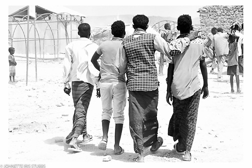 Young Afar men walking in the Asaita Refugee Camp, Afar, Ethiopia 2016