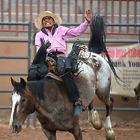 080615      Cayla Nimmo<br /> <br /> Wyatt Betony from Chinle competes in the bareback ride at the Ceremonial Rodeo at Red Rock park Thursday.