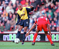 Thierry Henry (Arsenal) bends a shot around Curtis Fleming (Middlesbrough). Middlesbrough 0:1 Arsenal. F.A.Carling Premiership, 4/11/2000. Credit: Colorsport / Stuart MacFarlane.